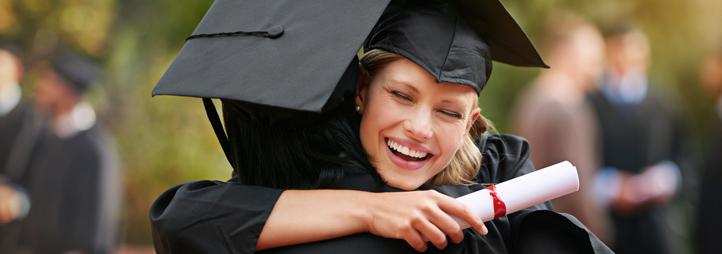 Graduating girls hugging