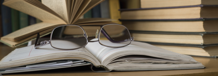 a pair of glasses on books