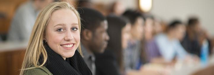 Undergraduate smiling female student in classroom