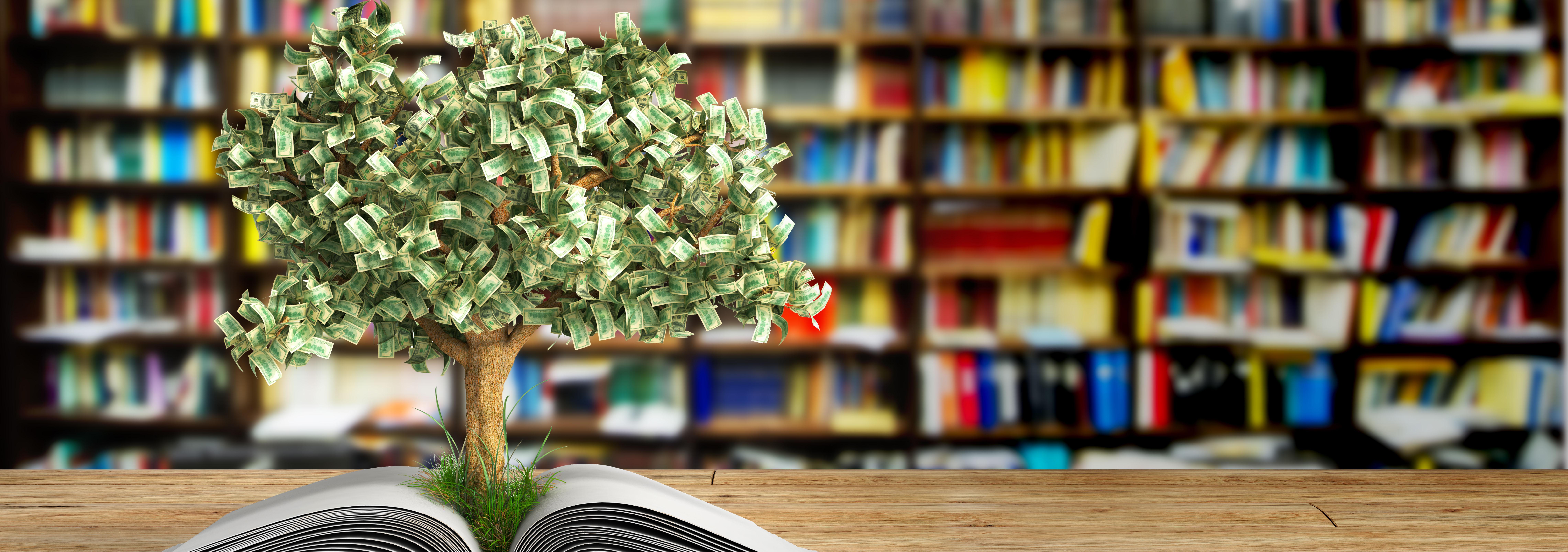 Un arbre avec de l'argent qui pousse d'un livre