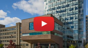 Front view of the Faculty of Social Sciences building, YouTube icon in centre of screen