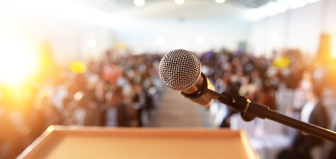 microphone facing blurred audience